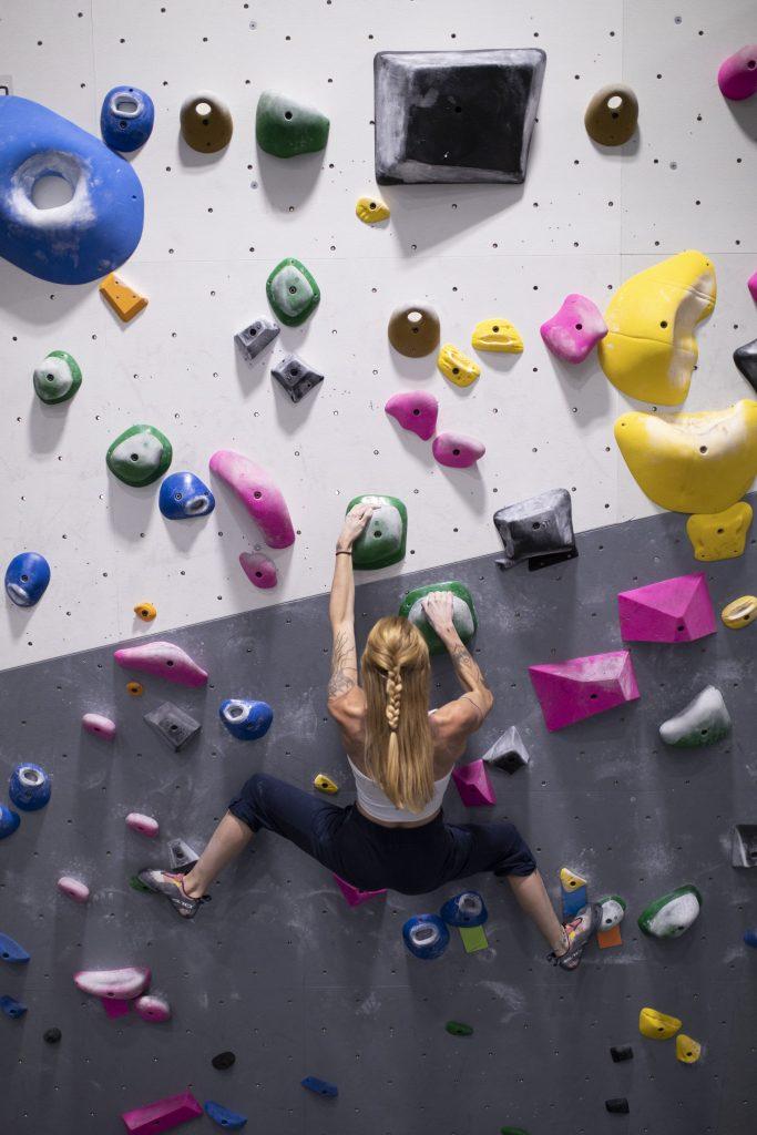 woman bouldering, climbing