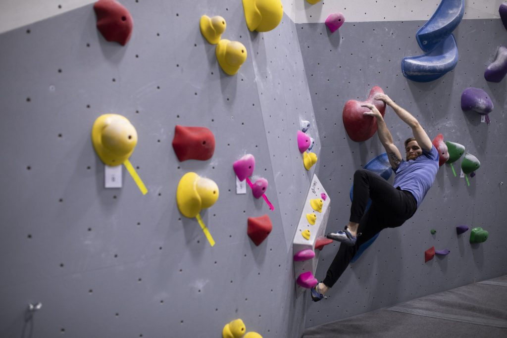 male bouldering, climbing