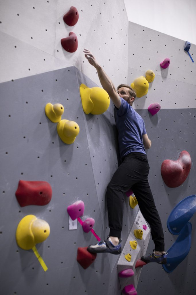 man bouldering, climbing easy problem