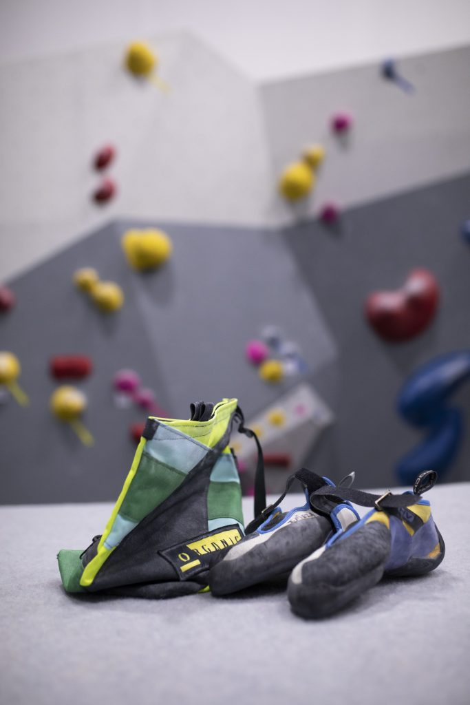 indoor climbing shoes and chalk bag on mat